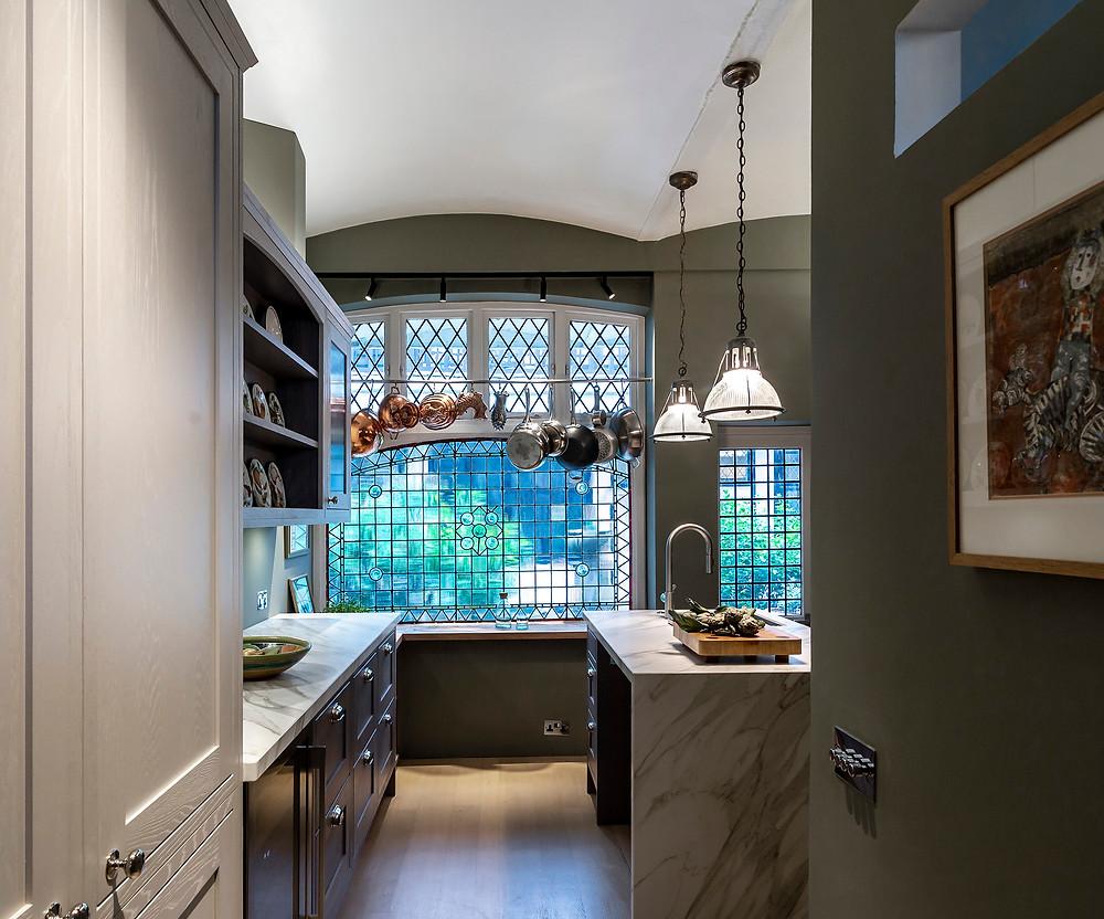 Prismatic glass kitchen pendant lighting with discreet black spotlights on track