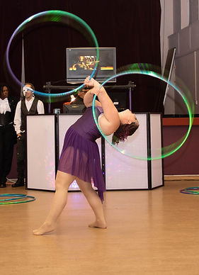 Violet Streak performing a back bend with her twin hoops