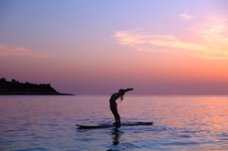 yoga exercise on paddle boards