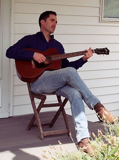Seth Littlefield performing on a 1963 Guild M-20 acoustic guitar outside his Seattle recording studio