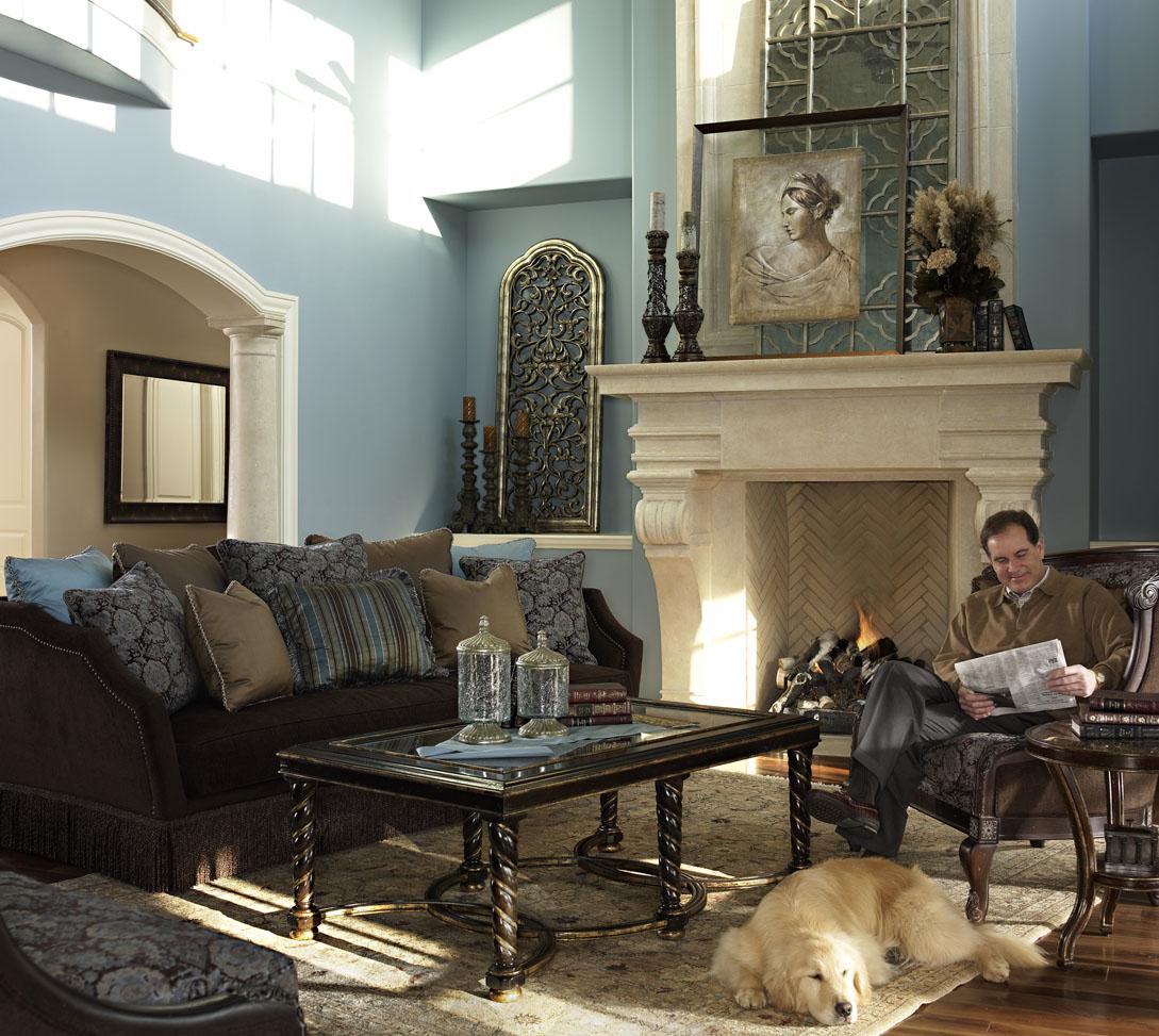 Mr. CBS, Jim Nantz sitting with dog