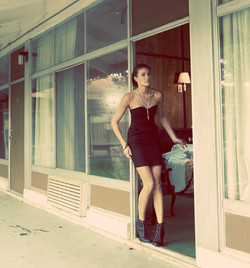 Model standing outside motel