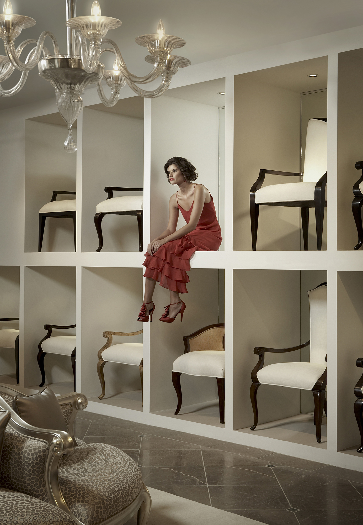 Model sitting in a furniture gallery