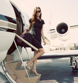 Model stepping off private plane