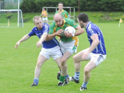 (Source: Leitrim Observer) Drumreilly's Declan Maxwell resists his opponents.
