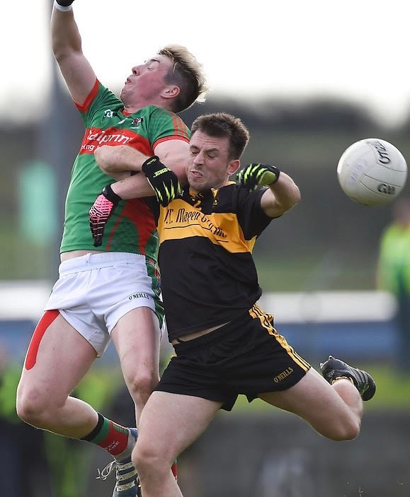 (Source: Clare Champion) John Payne battles for possession.