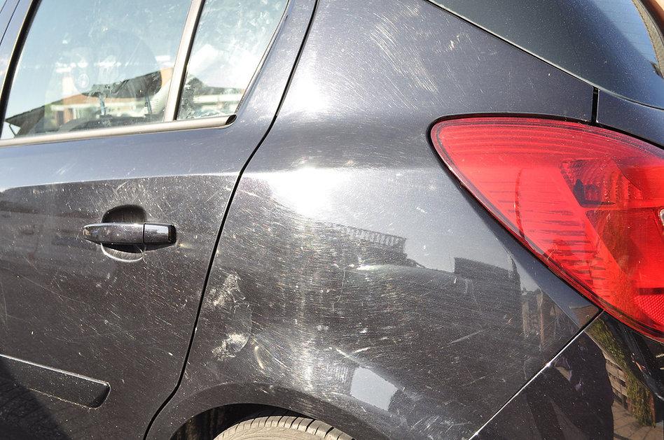 Achterdeur Opel Corsa vol krassen_orig.j