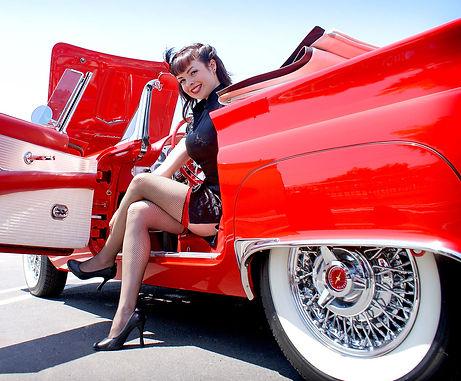 Pinup girl in old red cabriolet.jpg