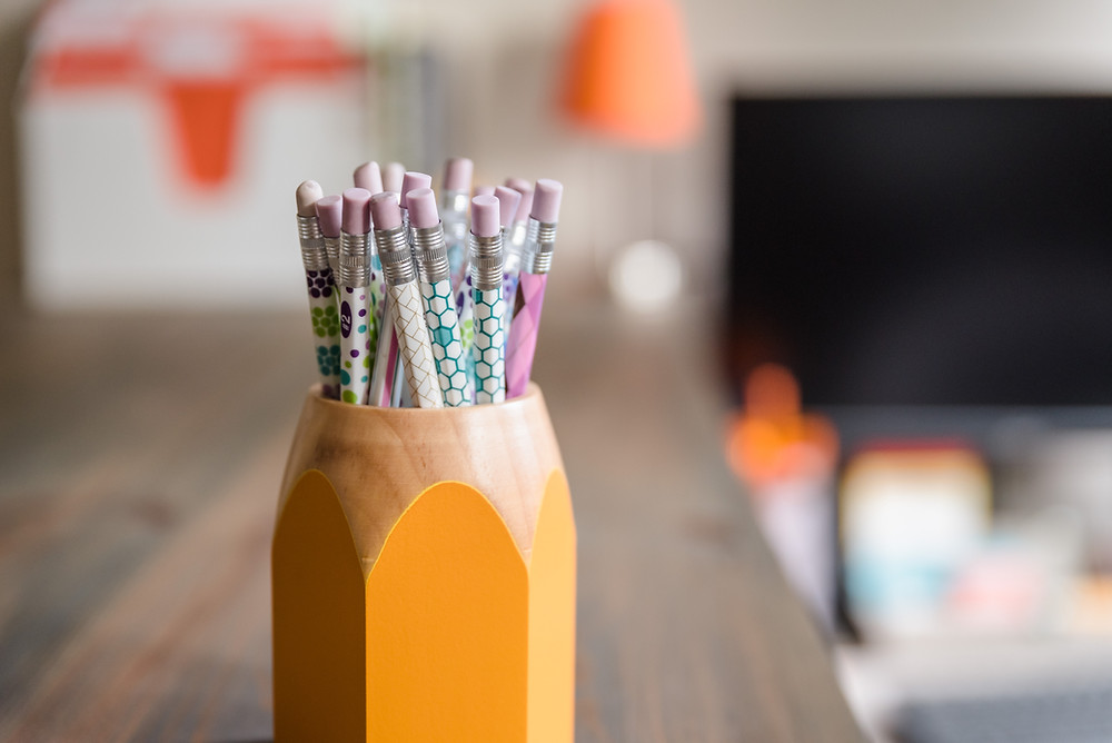 Desk with a pencil holder in the shape of a pencil with pencils in it! Pencil Point Marketing photo.