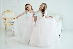 two little girls in wedding dresses stan