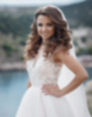 beautiful young bride stands on a rock i