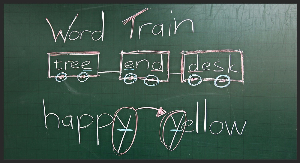 Blackboard whiteboard games Word Train Four dirty feet