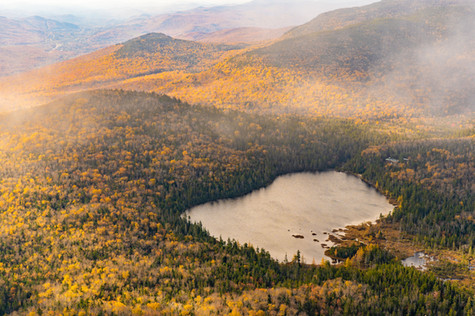 lonesome lake from above with valley to
