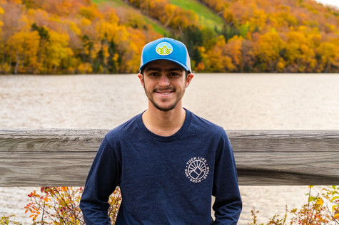 tuck mountain shirt forward and blue hat