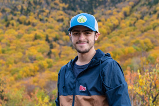 windbreaker and blue hat in front of can