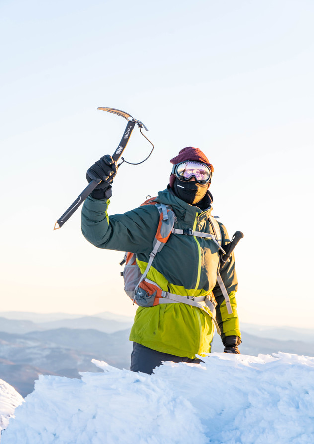 huzefa at summit with goggles and axe (1