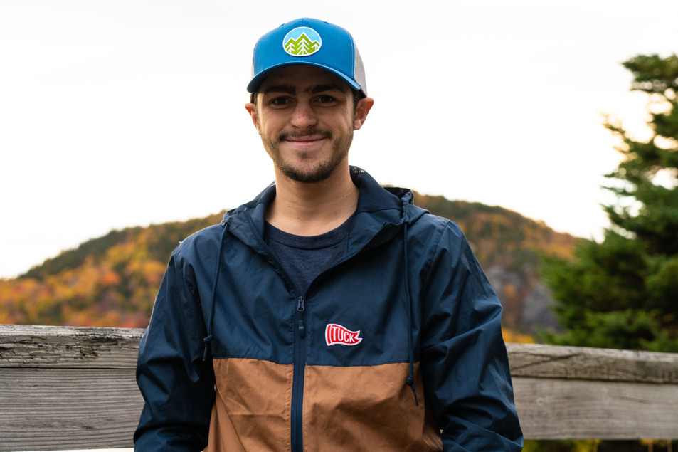 tuck windbreaker and blue hat smile 2 (1