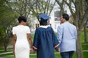 proud-parents-walking-daughter-during-gr
