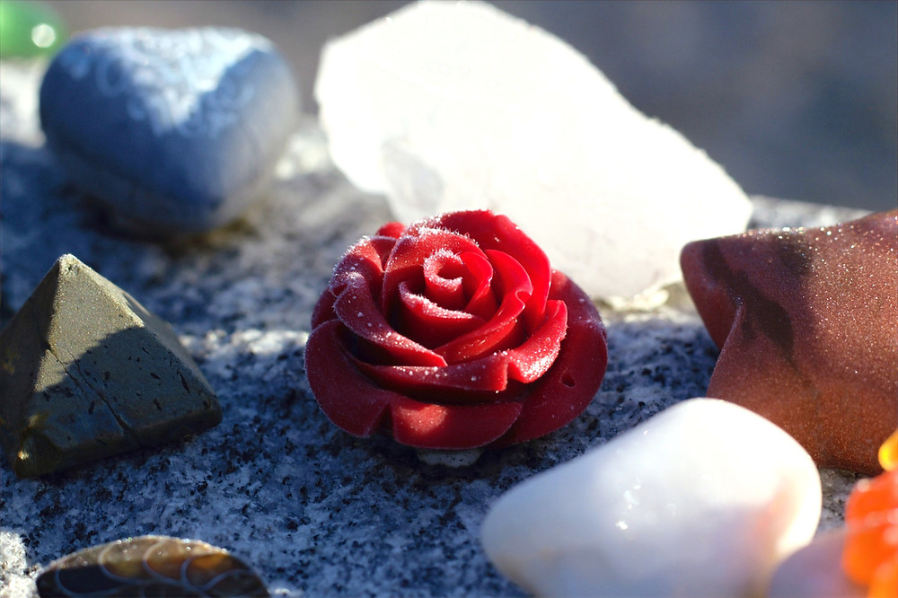 Photo 1: Little stone rose carving atop a gravestone at Mount Nebo, in Spokane.