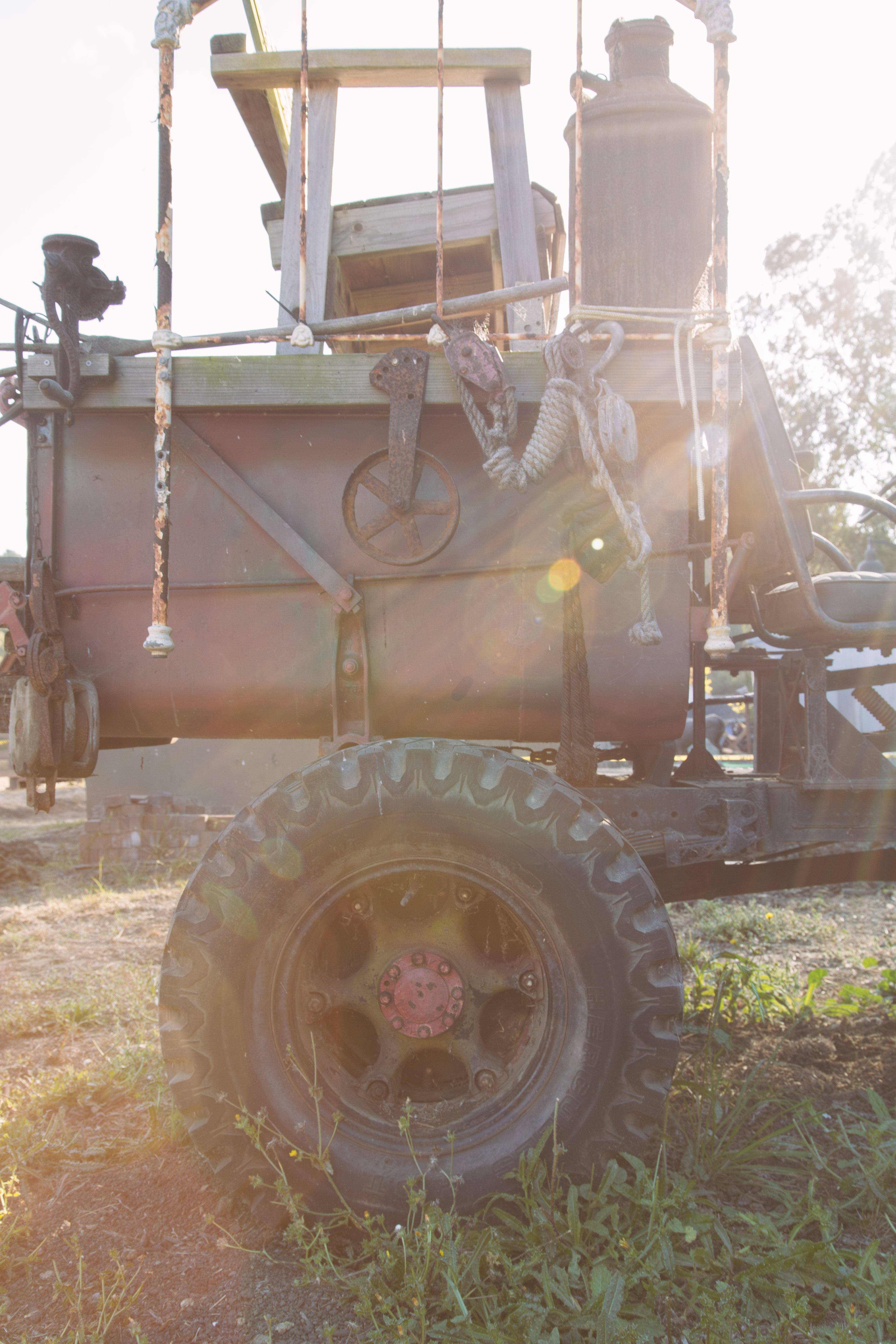 Rusty tractor truck with sun flare