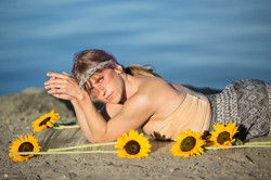 model surrounded by sunflowers