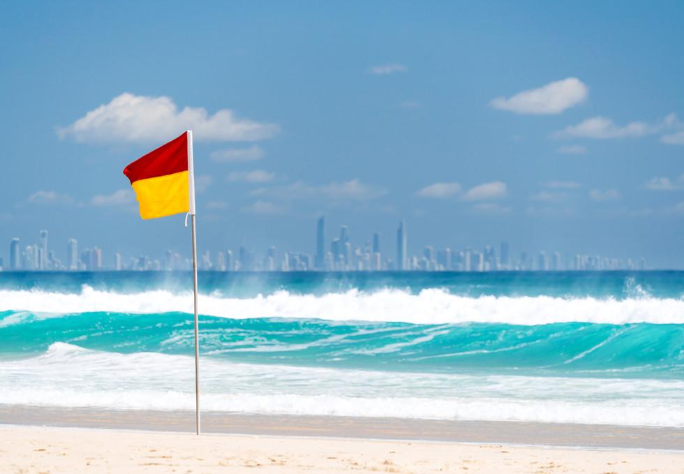Surf lifesaving flag on a beach at Coola