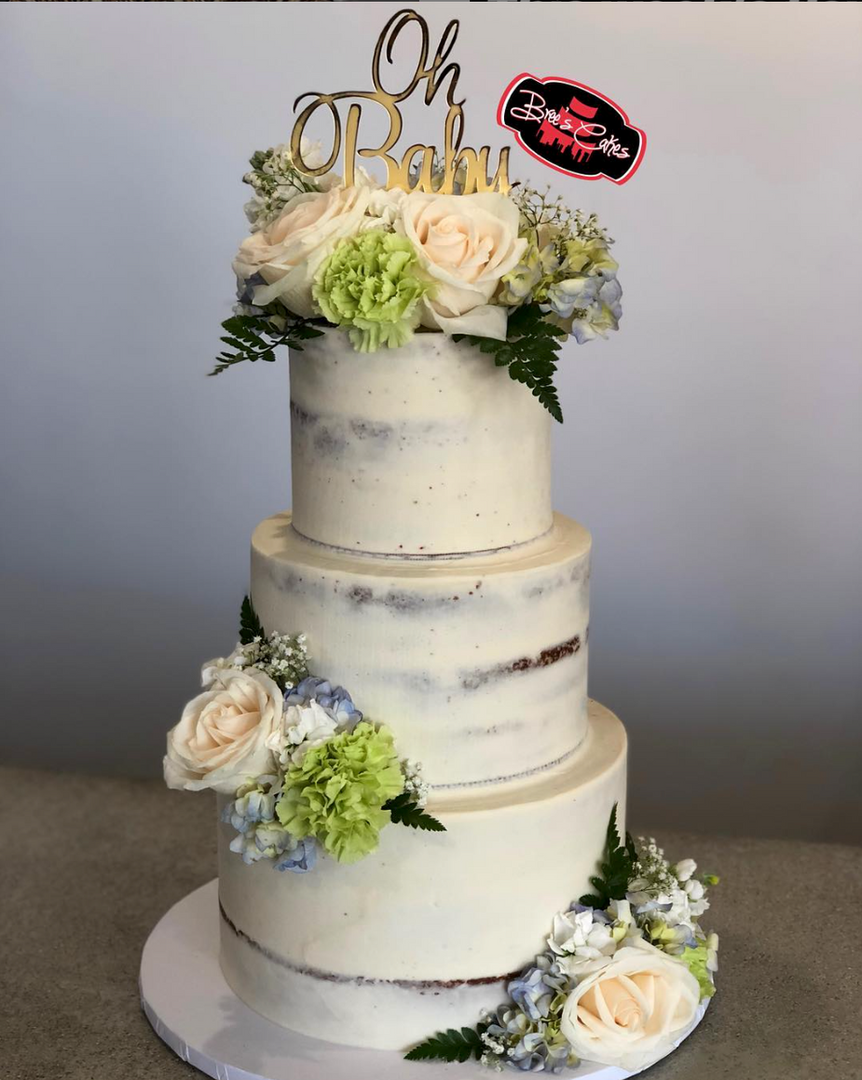 3 tier naked baby shower cake with florals