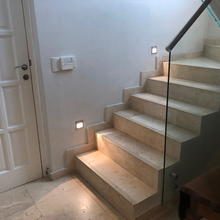 stair case from rooms to kitchen