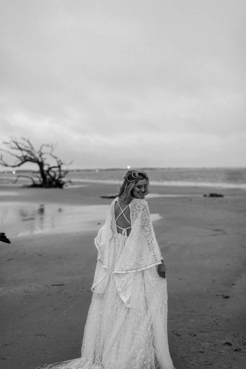 Bride Smiling at Sun Down on the Beach - Adventurous Elopement