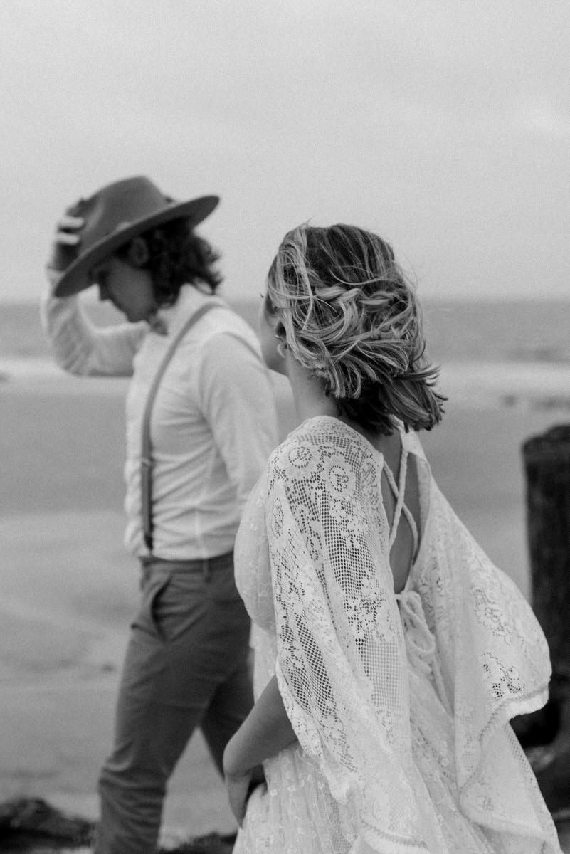 Bride and Groom walking on beach during Intimate boho elopement - Savannah Photographer