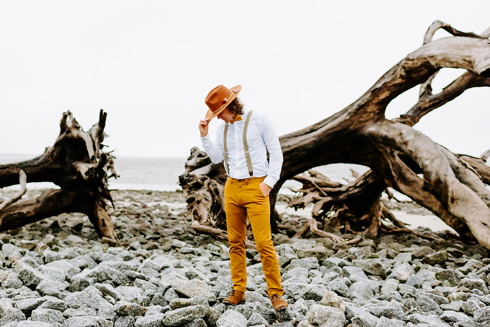 Boho Groom Standing on Rocks on Driftwood Beach - Savannah Wedding Photographer