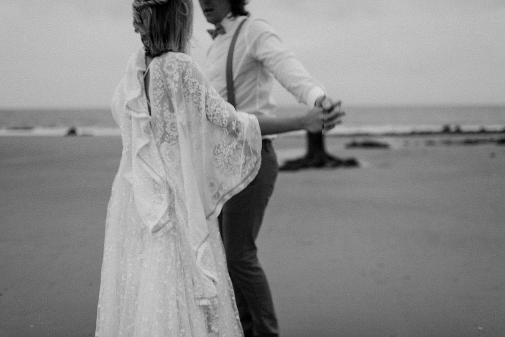 Bride and Groom Dancing on the Beach during Boho Elopement - Savannah Photographer