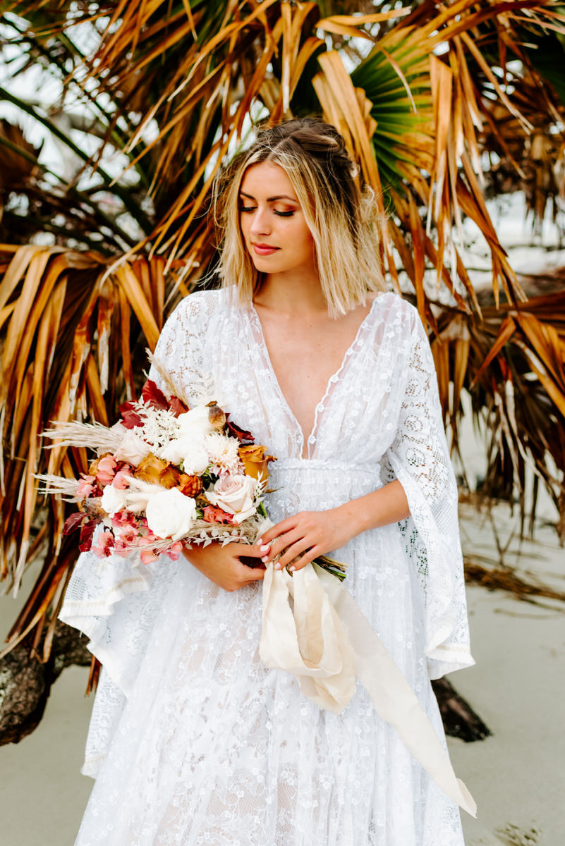Bride with Florals in front of Palm Tree - Savannah Wedding Photographer