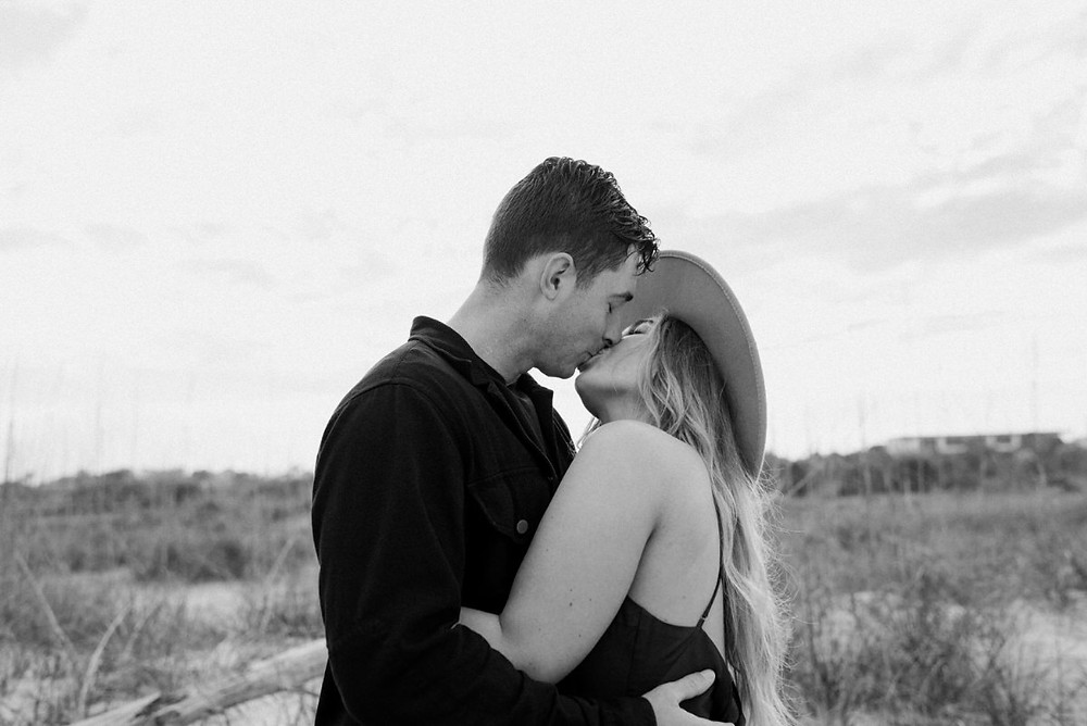 Man and Woman Kissing in Black and White. Golden Hour Beach Couples Session by Stephanie Cintron Photography.