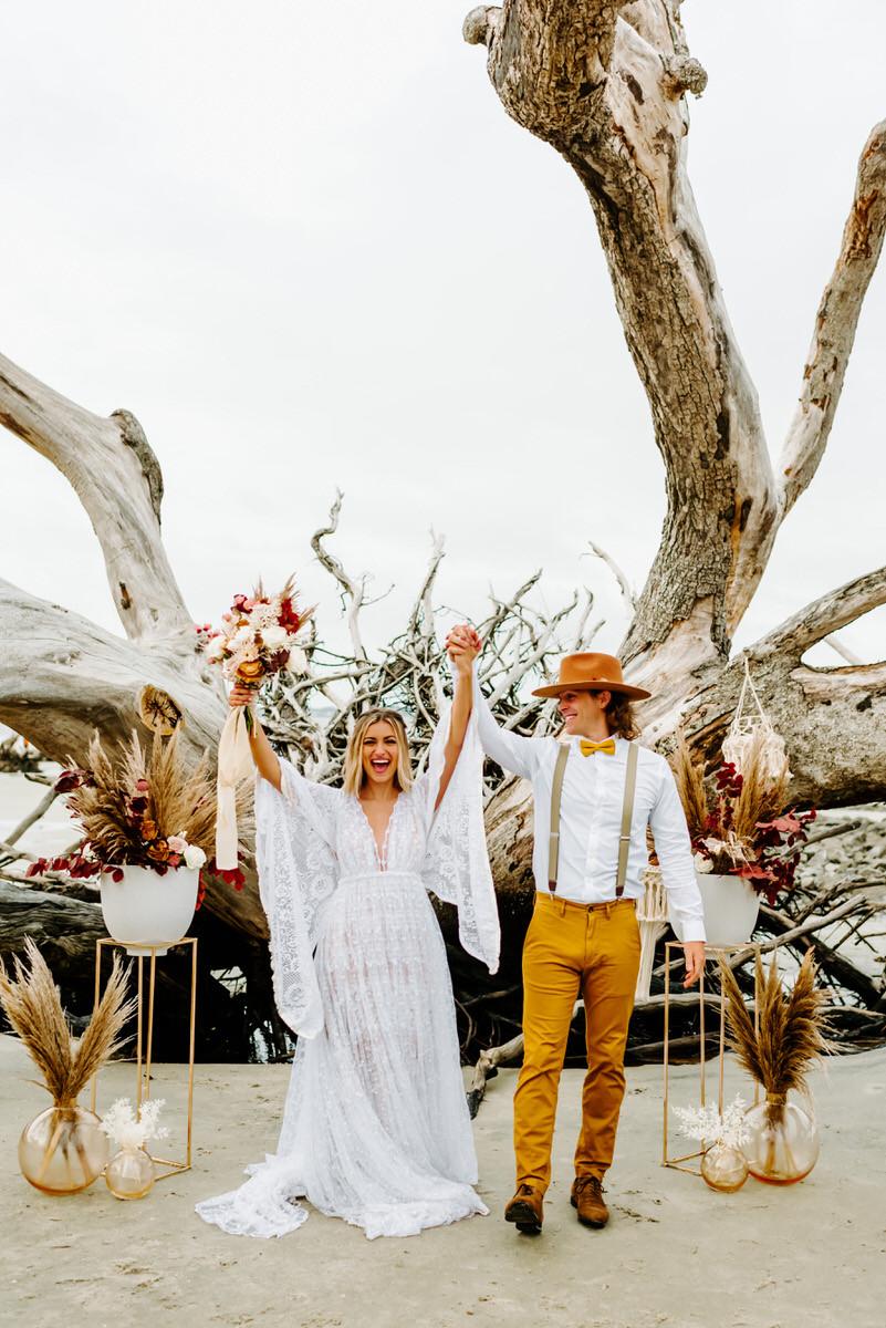 Bride and Groom Celebrating on Beach - Savannah Elopement Photographer