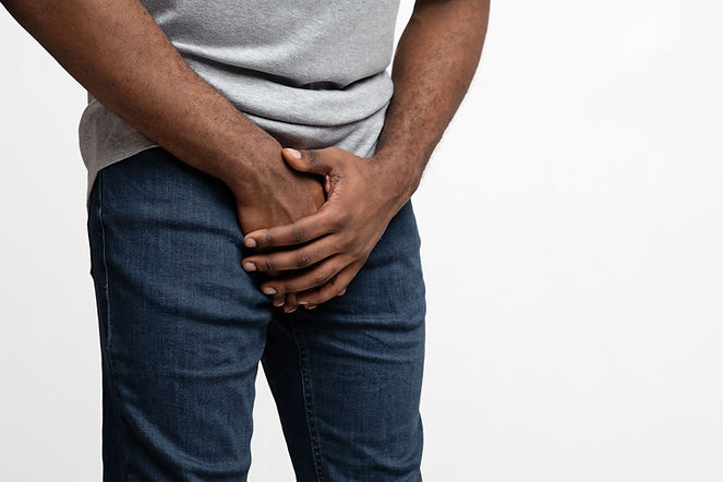 cropped-of-black-guy-holding-his-groin-N