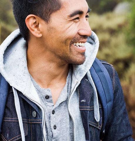 a-young-man-smiling-V9GH93K.jpg