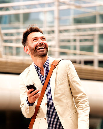 smiling-mature-man-outdoors-with-mobile-phone-PB28ME5_edited_edited.jpg