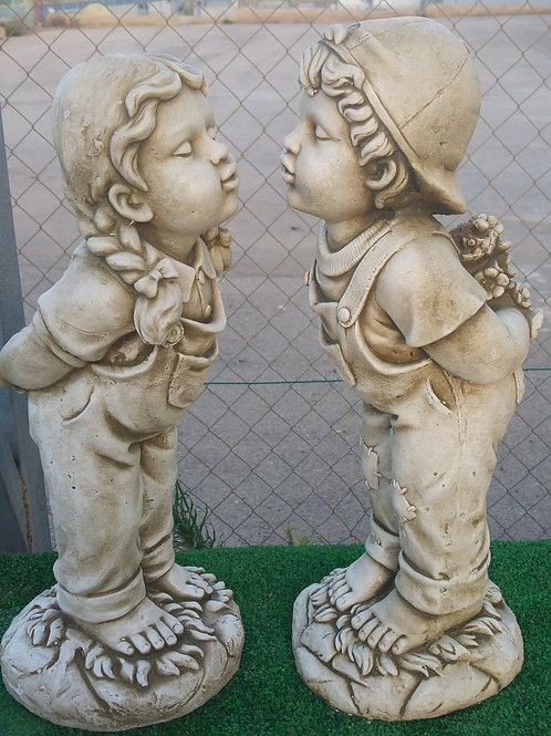 Concrete Boy and Girl Kissing