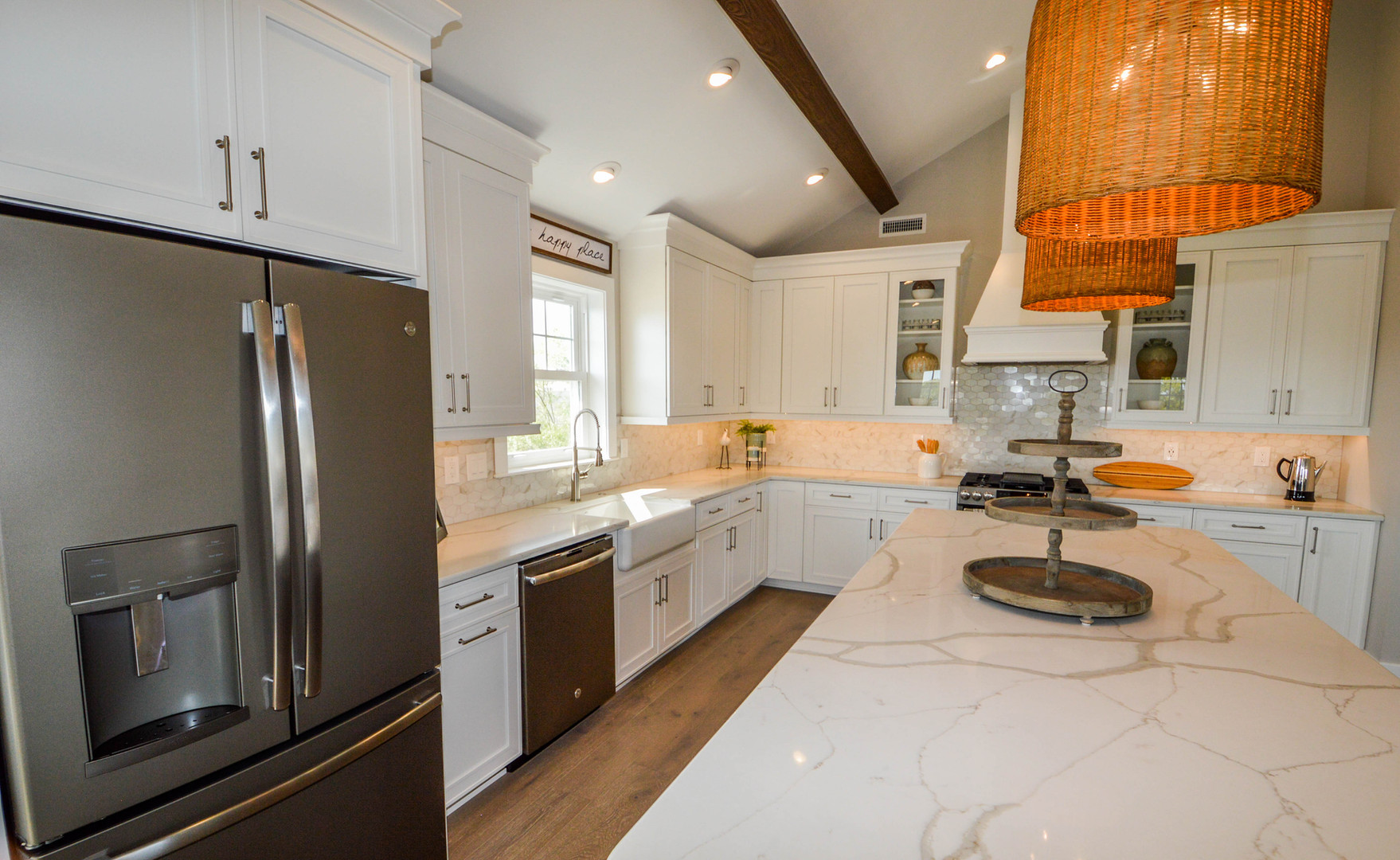 Thinking outside the box: Calcutta gold countertops and marble backsplash infused with basket weaved pendant lighting.  North Wildwood, NJ