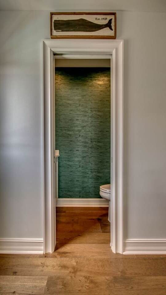 Pocket door to powder room with my favorite thing: Wallpaper.  Avalon, NJ