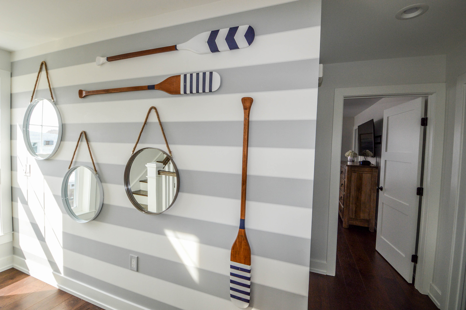Wallpaper is back. Nautical focal wall as a surprise on the stair landing.  North Wildwood, NJ