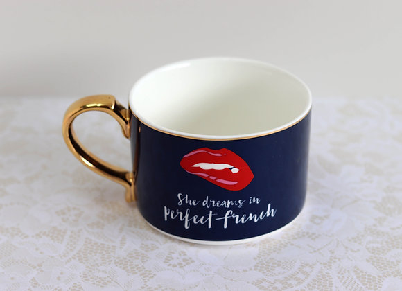 'she dreams in perfect french' mug