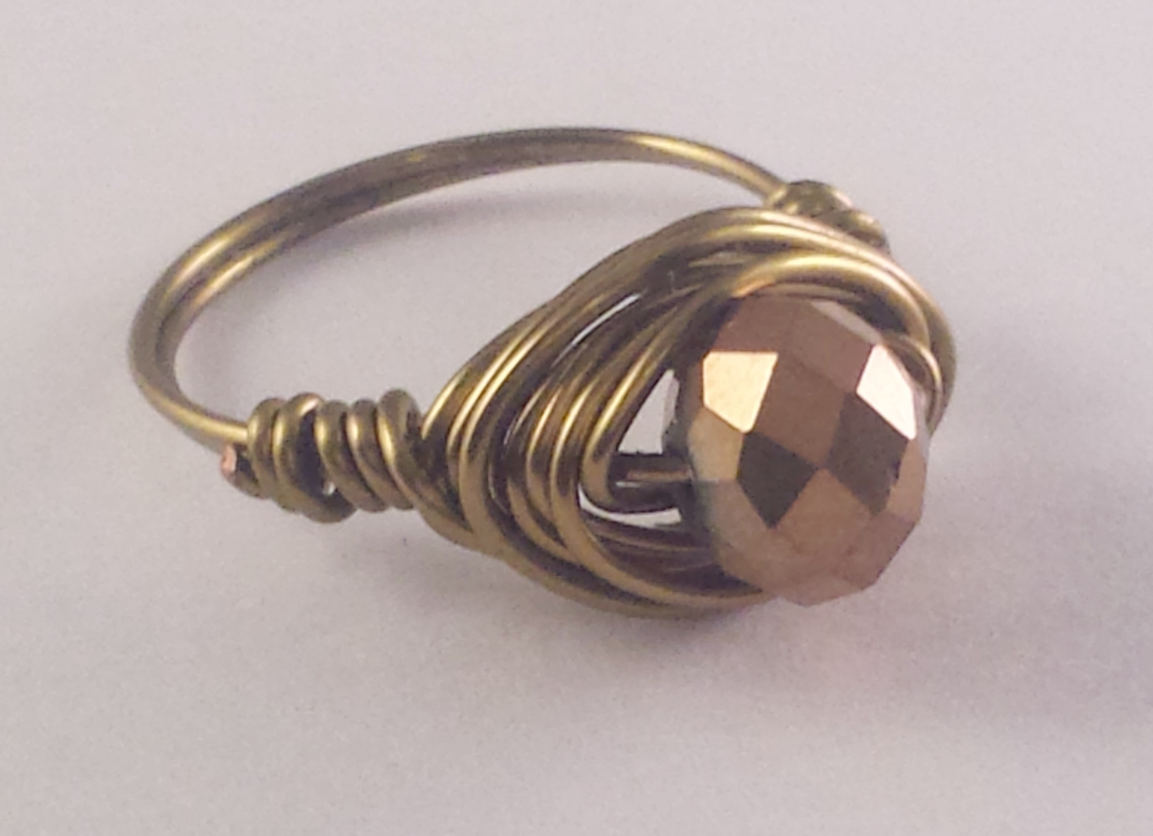 Handmade brass wrapped glass crystal rin
