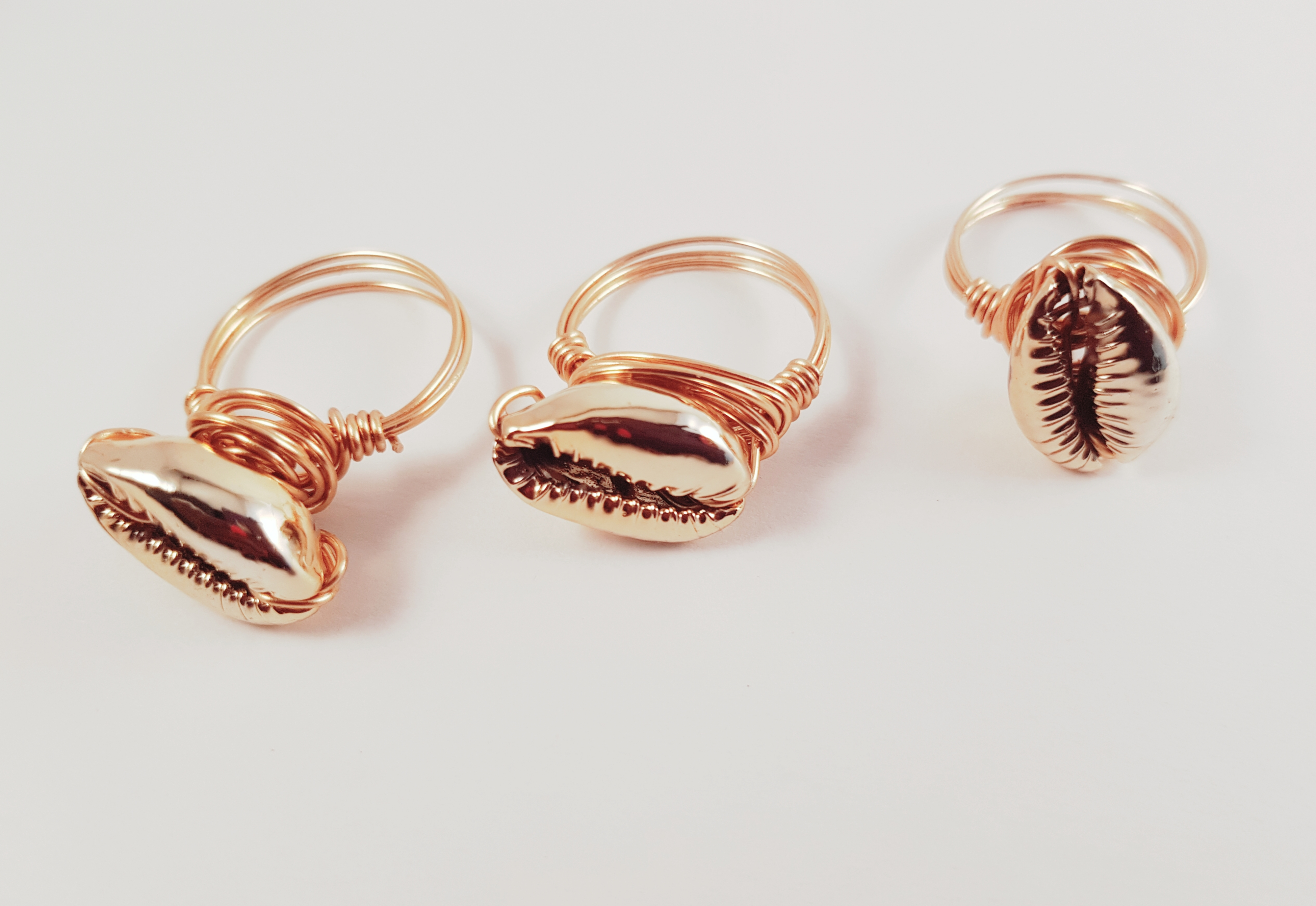 Hand wrapped Golden Cowrie shell ring