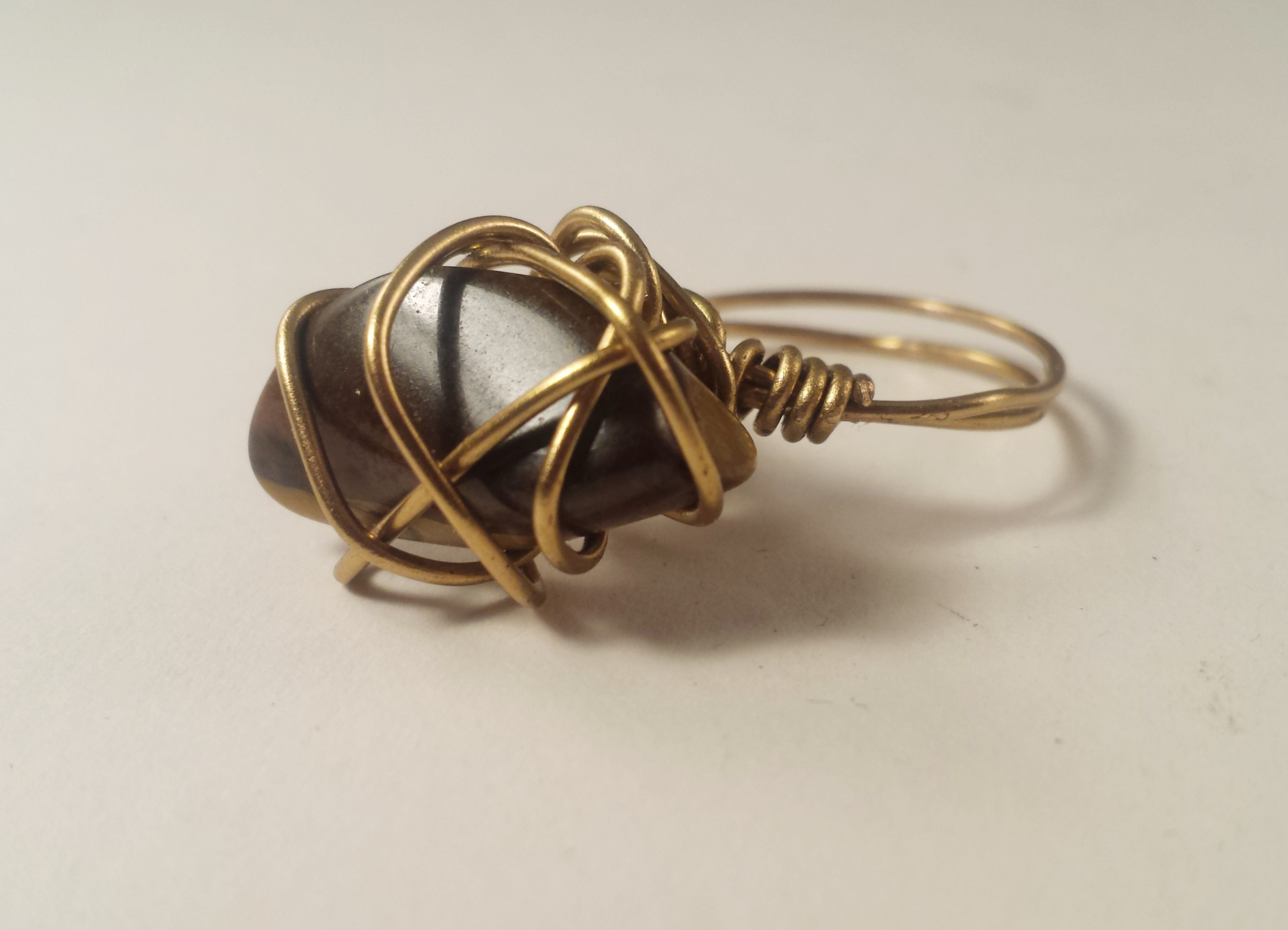 Hand wrapped brass ring with crystal Tig