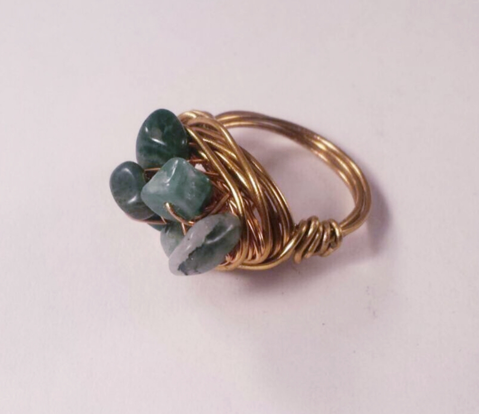 Handmade brass wire nest ring with Afric