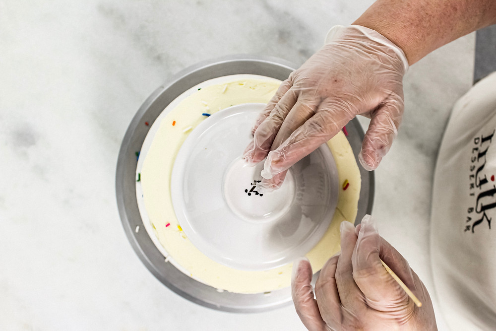 Cutting A Cake With A Plate