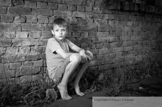 Boy at the brick wall