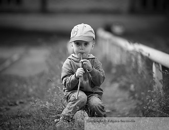 Little boy playing with wooden stick